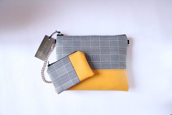 Pochette Lisbona 4 Pochette da mano o da utilizzare con tracolla. Tessuto Principe di Galles grigio e inserto in ecopelle in versione rossa o gialla. Dimensioni: 25 x 20 cm circa.